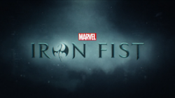 Iron Fist written in black writing, the letter O written in the form of a stylized dragon.