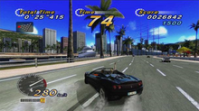Horizontal rectangle video game screenshot that is a digital representation of a city street. A dark-colored car drifts on the street. The screenshot depicts a heads up display that shows a speedometer at the bottom left and numbers at the top that shows a timer and scores.