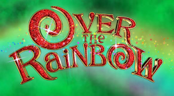 "The text ""Over the Rainbow"" in letters of mixed capitalisation, with the letters made up of red rubies set in gold frames; the letters 'O' are shaped as swirls. Behind the text is a rainbow, with a background of emerald green clouds on black."