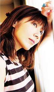 Ritsuko Okazaki on the cover of her album Love & Life (2005).