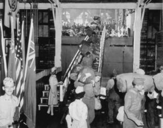 SS Cody Victory - Debarking the SS Cody Victory at Pier 8, Hampton Roads, in 1945 with 2,032 troops from Leghorn and Naples, Italy