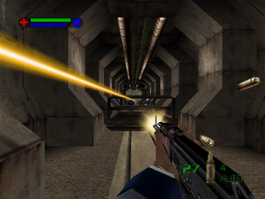 007: The World Is Not Enough (Nintendo 64) - Combat takes place in real-time and from a first-person perspective. The green and blue bars at the top left corner represent the player's health and armor levels respectively. Ammunition information is also displayed at the bottom right corner.