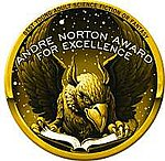 "A gryphon or eagle reading a book, partly overwritten by the caption ""Andre Norton Award for Excellence"", in a circular seal with ""Best Young Adult Science Fiction or Fantasy"" written around the top edge"