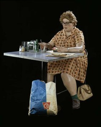 Hyperrealism (visual arts) - Duane Hanson, Woman Eating, polyester resin, fiberglass, polychromed in oil paint with clothes, table, chair and accessories, Smithsonian American Art Museum, 1971