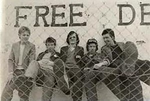 The Undertones - The Undertones standing beside the Free Derry mural in 1977