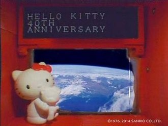 Hodoyoshi 3 - Hello Kitty, Looking at Earth out a window on the Hodoyoshi-3