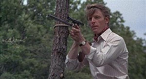 Jackal (The Day of the Jackal) - The Jackal (Edward Fox) practising with his newly customised sniper rifle.