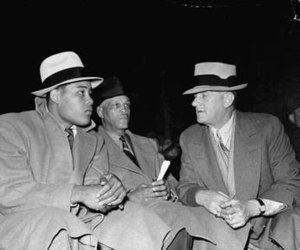 "Mike Jacobs (boxing) - Jacobs (right) with Joe Louis (left) and Louis' trainer Jack ""Chappie"" Blackburn ringside at the Henry Armstrong/Barney Ross bout at the Madison Square Garden Bowl, Long Island City, Queens, New York on May 31, 1938"