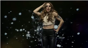 """Think About It (Melanie C song) - Melanie in the video for """"Think About It"""", the backdrop of the video changes throughout and shows Melanie surrounded by glitter at times."""