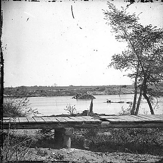 CSS Virginia II - Site of the sinking of Virginia II and other ships in the James River. The part showing above water is from CSS Jamestown. (Photograph by Mathew Brady)