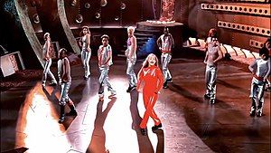 Oops!... I Did It Again (song) - Spears dances around wearing a red jumpsuit while surrounded by dancers in futuristic outfits during the music video.