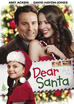 "An image of a man, woman, and child and a postage letter with the words ""Dear Santa"""