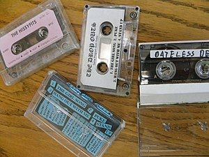 Demo (music) - Representative examples of unsolicited demo tapes received in the mail by Mutant Pop Records in the late 1990s. The tape in the middle with the photocopied j-card was probably also sold at shows by the band.