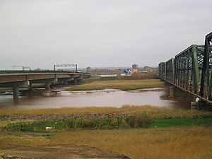 Gunningsville Bridge - View of the old Gunningsville Bridge (right) next to the new bridge (left). The old bridge was demolished when the new one opened late in 2005.