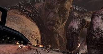 God of War III - Kratos (bottom left) battles enemies on Cronos' arm. The image also depicts the size of the Titans featured in the game.