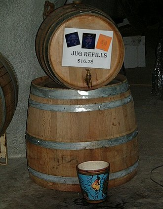 Jug wine - A refilling station for wine jugs in a winery.