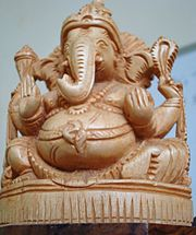 A statue of Ganesha carved in wood.