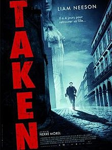 The word TAKEN written vertically in red, alongside a man is running towards the viewer.
