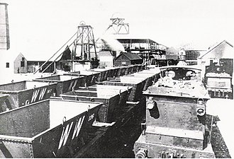 West Wallsend, New South Wales - West Wallsend Colliery c1890s, showing main shaft (centre) and air shaft (left), with locomotives at the ready for coal haulage to port