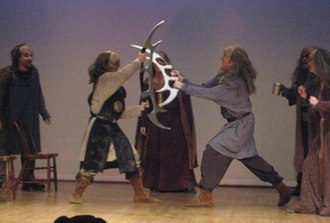 A Klingon Christmas Carol - Bat'leth fight from premiere production of A Klingon Christmas Carol in 2007 with Brian Watson-Jones as vred (left) and Scot Moore as Warrior 2 (right). Commedia Beauregard file photo.