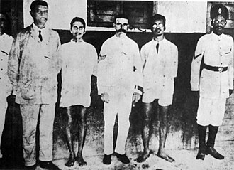 Emperor vs Aurobindo Ghosh and others - Kanailal Dutt (2nd from right) and Satyen Basu (4th from right), under arrest after assassinating Naren Goswami.