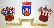 The twinning emblems for Cheltenham, Gottingen and Toruń