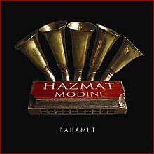"A red harmonica sits on a black background, labeled ""Hazmat Modine"" with ""Bamahut"" in small white letters below. Five brass musical horns protrude from above the harmonica."