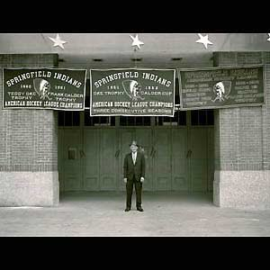 Springfield Indians - Owner Eddie Shore at the Eastern States Coliseum with the Springfield Indians' championship banners.