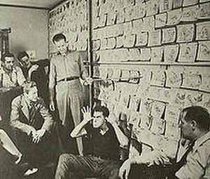Good Scouts - Carl Barks (standing with pointer) and Harry Reeves (clowning) present the storyboard for Good Scouts in 1937