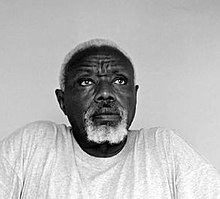 black-and-white portrait of an elderly African man with white hair and beard