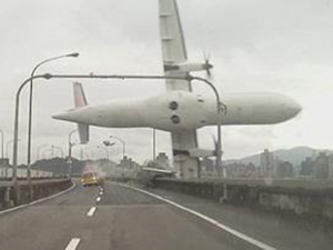 TransAsia Airways Flight 235 - Still from a dashcam video, showing Flight 235's left wing clipping a taxi and the Huandong Viaduct, seconds before the aircraft crashed into the Keelung River