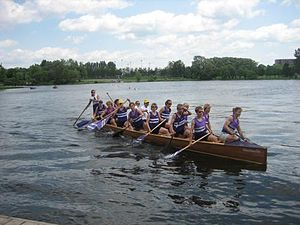 War canoe - Ladies war canoe pushes off the dock to compete in the annual Canada Day regatta held at the Rideau Canoe Club.