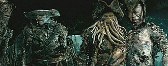Davy Jones (Pirates of the Caribbean) - Jones and some of the Flying Dutchman crew after Will challenges him to Liar's Dice.