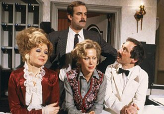 Fawlty Towers - Cast of Fawlty Towers, left to right: (front) Prunella Scales, Connie Booth, and Andrew Sachs; (back) John Cleese