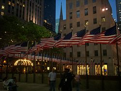 The flagpoles surrounding the Lower Plaza, with American flags on them