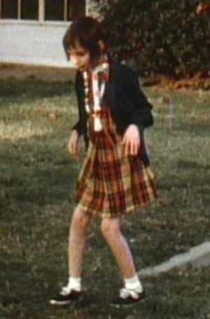"""Genie (feral child) - Genie in the Children's Hospital yard a few weeks after her admission, displaying her characteristic """"bunny walk""""."""
