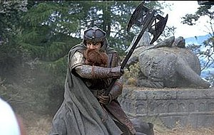 Gimli (Middle-earth) - John Rhys-Davies as Gimli in Peter Jackson's The Lord of the Rings: The Fellowship of the Ring.