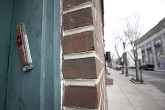 Mezuzah - Mezuzah affixed to a door frame on South Street in Philadelphia.