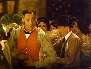 On with the Show! (1929 film) - Sam Hardy orange vest. A frame from a surviving 20 second color fragment found in 2005.