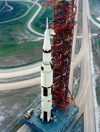 Kennedy Space Center - A Saturn V carrying Apollo 15 rolls out to Pad 39A in 1971 on Mobile Launch Platform 1.