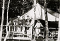 Camp Highlands Tent Crew with Golden Retreiver, Flag and Bunks circa 1915.jpg