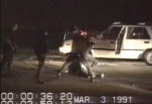 Rodney King - Screenshot of King being beaten by LAPD officers