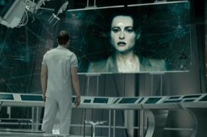 Skynet (Terminator) - Helena Bonham Carter as Skynet, under  the guise of the late Dr. Serena Kogan on a monitor, with Sam Worthington as Marcus Wright.