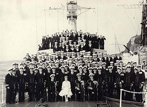 Commander-in-Chief of the Canadian Armed Forces - Elizabeth II, Queen of Canada, in her role as Commander-in-Chief of the Canadian Militia and Naval and Air Forces, pictured with the crew of HMCS St. Laurent in Stockholm, Sweden, 11 June 1956