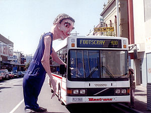 Footscray, Victoria - A Snuff Puppet greets a bus in Paisley Street, Footscray