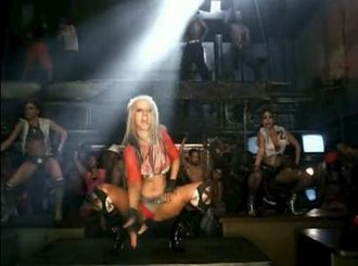 """Dirrty - A scene from the music video for """"Dirrty"""", in which Aguilera performs the slutdrop. The music video is credited as the origin of the slutdrop, which later became popular among contemporary female artists."""