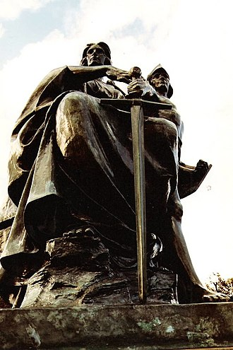 Alexander Carrick - The Fraserburgh war memorial featuring Carrick's allegorical group 'Justice Guiding Valour'.  'Justice' restrains 'Valour' with a light touch of her finger, an action which is perhaps reminiscent of the light touch of the angel waking the Magi on the capital at Autun by Gislebertus.