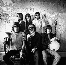 Jefferson Airplane photographed by Herb Greene at the Matrix club, San Francisco, in 1966. Top row from left: Jack Casady, Grace Slick, Marty Balin; bottom row from left: Jorma Kaukonen, Paul Kantner, Spencer Dryden. A cropped version of this photo was used for the front cover of Surrealistic Pillow.