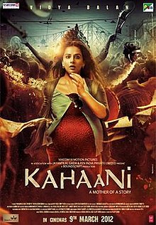 Theatrical release poster depicts a pregnant woman, with a sightly surprised expression, standing. The city of Kolkata, during Durga Puja, is in the background. Text at the bottom of the poster reveals the title, tagline, production credits and release date.
