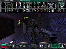 An in-game System Shock 2 gameplay screenshot, showcasing the interaction menus. A hand is holding a silver pistol while the mouse is pointed at an unknown robotical being, while on top of the screenm several minor objects are shown organised as in inventory.